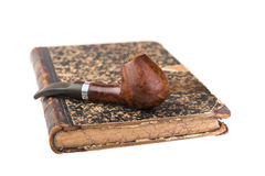 Tobacco pipe on vintage book Stock Photography