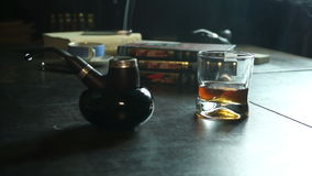 Tobacco pipe, whiskey and smoke stock footage