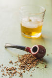 Tobacco Pipe and Whisky Royalty Free Stock Photography