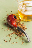 Tobacco Pipe and Whisky Royalty Free Stock Images