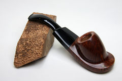 Tobacco pipe and wood stock photography
