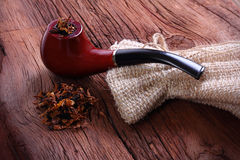 Tobacco with pipe Stock Images