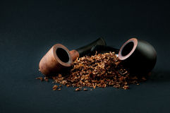 Tobacco and pipes Stock Images
