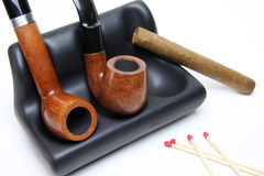 Tobacco pipes and cigar royalty free stock photos