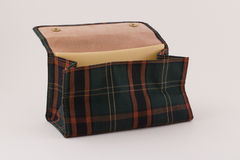 Tobacco pouch. / bag to hold or carry pipe tobacco. Plaid green exterior and suede leather interior. Ideal for e-commerce website stock photos