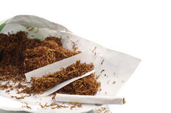 Tobacco and rolled cigarettes Stock Photo