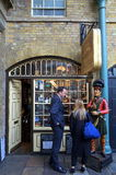 Tobacco Shop in London. London, England - Sept 09, 2015: People at the window display of Segar & Snuff Parlour in Covent Garden, London. The store is a Stock Image
