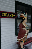 Tobacco shop - Mystic Seaport, Connecticut, USA. Tobacco shop at Mystic Seaport, Connecticut, USA with statue of Indian woman on porch near Cigars sign Stock Photo