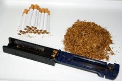 tobak och cigaretter arkivfoto