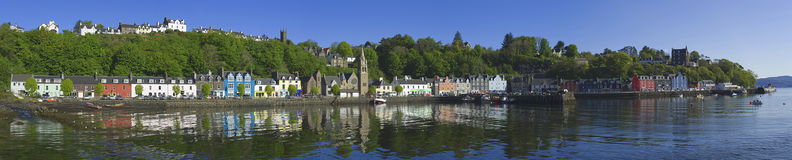Tobermory. Panorama of the entire length of the main street of Tobermory, Isle of Mull, Scotland, in the light of a fine, early summers morning. One of the most Stock Photo