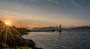 Tobermory lighthouse, scotland. Sunset at tobermory lighthouse on the isle of mull scotland Royalty Free Stock Images