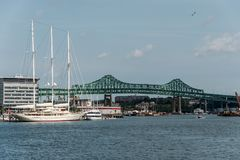 Tobin bridge in Boston MA, USA and the Athena 295 foot yacht docked at the Boston harbor Royalty Free Stock Photography