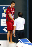 Toblas Oriwol. Of Canada accepts the bronze medal for his performance in the 400m IM event at the 2010 Fina Swimming World Cup. Singapore 16/10/2010 Royalty Free Stock Photos