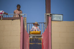 On toboggan down a steep water slide Stock Images