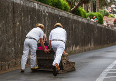 Toboggan riders on sledge in Monte - Funchal Madeira Portugal Stock Images