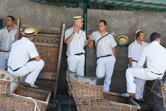 Toboggan sledge riders waiting for tourists in Madeira, Portugal Stock Photography