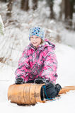 Tobogganing on an old wooden sled Royalty Free Stock Photography