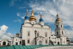 St Sophia-Assumption Cathedral in Tobolsk Kremlin. Tobolsk, Russia - July 15, 2016: Kremlin complex. Group of tourists near St Sophia-Assumption Cathedral and Royalty Free Stock Images