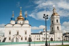 St Sophia-Assumption Cathedral in Tobolsk Kremlin. Tobolsk, Russia - July 15, 2016: Kremlin complex. Group of tourists near St Sophia-Assumption Cathedral and Stock Images