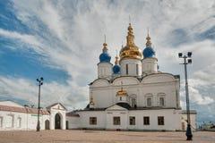 St Sophia-Assumption Cathedral in Tobolsk Kremlin. Tobolsk, Russia - July 15, 2016: Kremlin complex. Woman goes near St Sophia-Assumption Cathedral and belltower Stock Photos