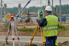Surveyor builder worker with theodolite royalty free stock photos