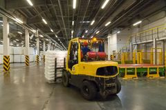 Forklift truck loads pallets with finished goods Royalty Free Stock Images