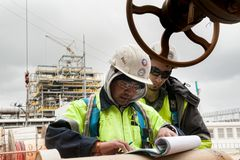 Worker on a construction site check documents Royalty Free Stock Photo