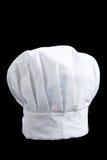 Toca de un panadero blanco en un fondo negro Foto de archivo