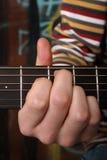Tocando la guitarra vea la otra foto Fotos de archivo libres de regalías