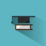 Tocco con l'icona del libro su fondo blu con ombra Immagini Stock