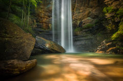Cove of Toccoa Falls. Waterfalls in a rocky cove of Toccoa Falls, GA Royalty Free Stock Image