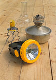 Tocha, lâmpada de querosene e vela Imagem de Stock
