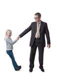 Tochter zieht Vater für Hand Lizenzfreie Stockfotos