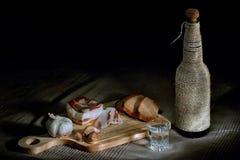 Tocino, pan, ajo y vodka Imagen de archivo libre de regalías