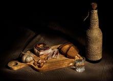 Tocino, pan y vodka Foto de archivo