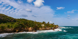 Toco Trinidad and Tobago West Indies rough sea beach cliff edge panorama Royalty Free Stock Image