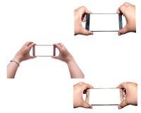 Toda la mano con smartphone aislada, trayectoria de recortes Foto de archivo libre de regalías