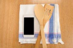 Todas as receitas de cozimento em meu smartphone Fotos de Stock
