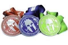 Todas las medallas espartanos de la raza - esprinte estupendo y la bestia Fotografía de archivo