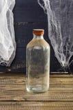 Todavía botella de cristal polvorienta de la vida Imagen de archivo libre de regalías