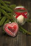 Todavía de la Navidad la vida con la vela y el corazón forman la decoración Fotografía de archivo