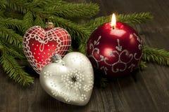 Todavía de la Navidad la vida con la vela y el corazón forman la decoración Imagenes de archivo
