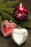 Todavía de la Navidad la vida con la vela y el corazón forman la decoración Imagen de archivo libre de regalías
