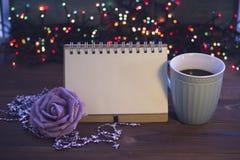 Todavía de la Navidad vida con café, el juguete y un cuaderno Imagen de archivo libre de regalías