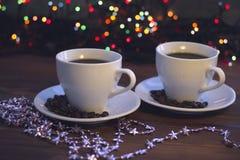 Todavía de la Navidad vida con dos tazas de café con los platillos Fotografía de archivo libre de regalías