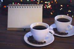 Todavía de la Navidad vida con dos tazas de café con los platillos Fotografía de archivo