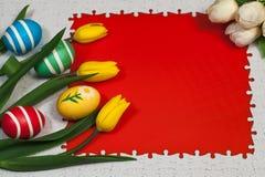 Todavía de Pascua vida en un fondo rojo Imagen de archivo