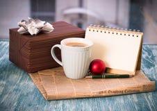 Todavía de RFestive vida con la caja, taza, bola, periódico, cuaderno Fotos de archivo libres de regalías