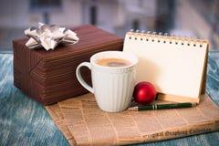 Todavía de RFestive vida con la caja, taza, bola, periódico, notebok Imagen de archivo libre de regalías