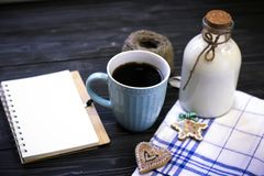 Todavía de RFestive vida con una botella, una taza, un cuaderno Imagen de archivo